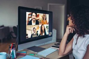 Woman looking at a video conference meeting.