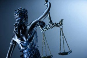 Blind Justice holding the scales statue